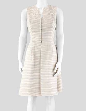 Akris cream sleeveless dress made of silk with neutral stripe layering and a V-neck snap front. Size 6 US
