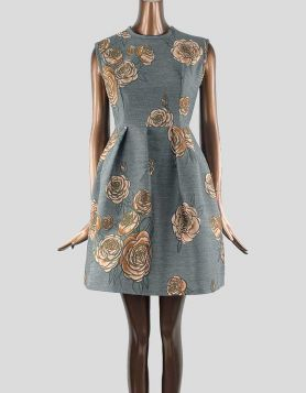 Aquilano.Rimondi A-Line dress in grey with brown and black flowers. Sleeveless and crewneck. Floral print throughout. Exposed zip closure at back. Size 6 US