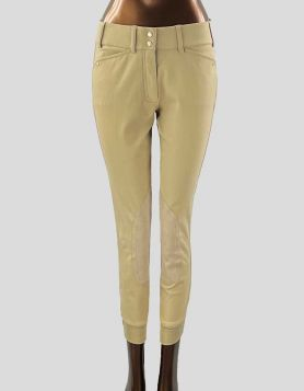 Ariat low-rise front zip, knee patch equestrian riding pants in tan with elasticated ankles. Front zip and two-clasp closure. Size 26 R