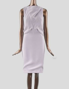 Balenciaga sleeveless evening dress with draping design in front and back. Partially bare in back. Concealed zip closure at back. Lined. Size 40 FR
