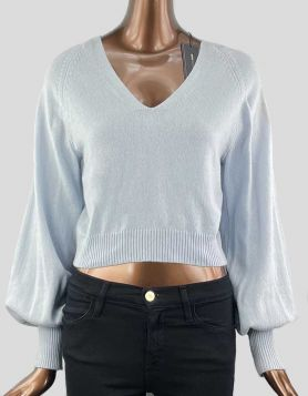 BCBG Max Azria knit cropped sweater with billowing balloon sleeves features a V-Neck with ribbed trim details. Pullover.  Size: Medium