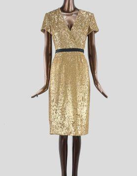 Burberry London gold sequin wrap-effect evening dress with black grosgrain belt at waist.