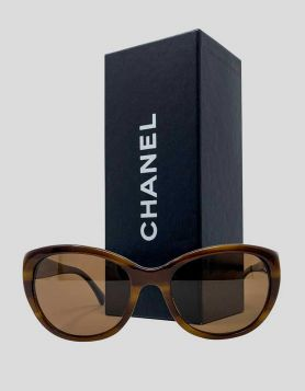 Chanel Sunglasses with flower detail on arms - front
