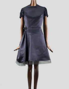 Christian Dior Silk A-Line Dress in navy blue with pleated accent at right side. Short sleeve with crew neck. Size: 8 US