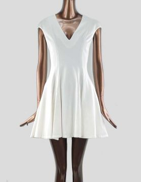 Cushnie Et Ochs A-Line Dress in white. Cap sleeves with V-Neck. Concealed zip closure at back. Lined. Size 10 US