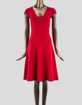 Donna Karan New York A-line knit dress featuring cap sleeves and V-Neck. Pull-on style.