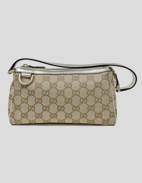 Gucci GG Canvas Abbey D-Ring Pochette in brown with gold leather trim. GG Canvas with gold-tone hardware.