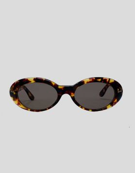 Gucci oval sunglasses in tortoise acetate with gold-tone Gucci branding on arms, and tinted lenses