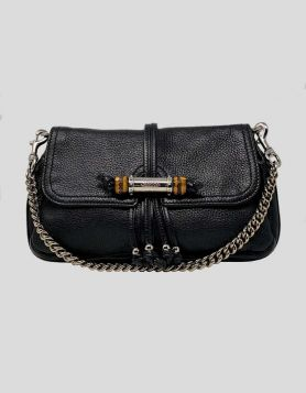 Authentic Gucci Bamboo Croisette Evening Bag. The flap features a silver and bamboo closure with black leather fringe and opens to a black Gucci fabric with a patch pocket