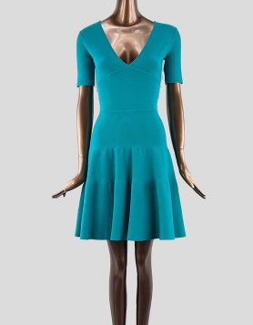 Issa A-line knit mini dress featuring V-neck and short sleeves. Concealed back zipper. Size: Small
