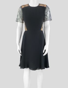Jason Wu black silk dress updated with black lace accents. Size 6 US
