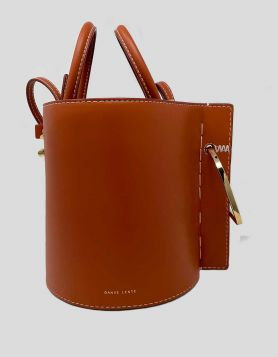 Actress Kristen Bell's Danse Lente Bobbi Bucket Bag in tan leather with gold-tone hardware, being sold to support Children's Hospital Los Angeles.