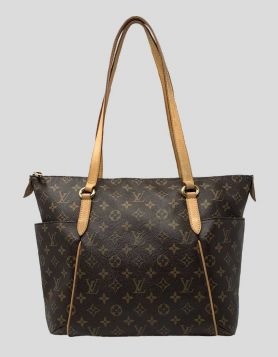 Authentic Louis Vuitton Totally PM handbag with brass hardware, dual leather shoulder straps and dual slit pockets at exterior sides