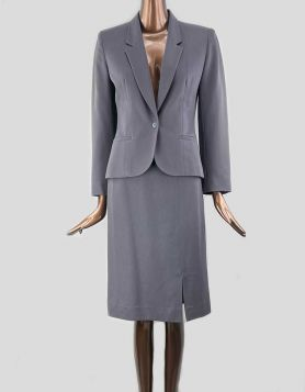 Paul Stanley grey skirt suit in light-weight wool, year-round material. High-waisted, straight skirt with concealed back zip closure and front side slit.