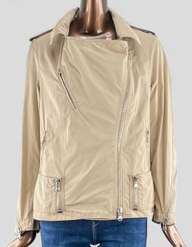 Phillip Lim oversized biker jacket in tan nylon. Featuring off-center front zip closure, epaulets at shoulder, three front zip pockets, and zip closure sleeves.